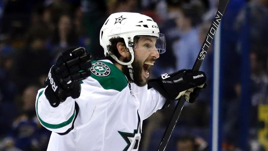 Dallas Stars' Jason Demers celebrates after the Stars' 3-2 overtime victory against the St. Louis Blues in Game 4 of the NHL hockey Stanley Cup Western Conference semifinals, Thursday, May 5, 2016, in St. Louis. (AP Photo/Jeff Roberson)