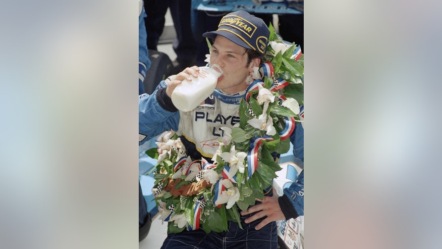 FILE - In this May 28, 1995 file photo, Jacques Villeneuve drinks milk in Victory Lane after winning the 79th running of the Indianapolis 500 auto race at Indianapolis Motor Speedway. (AP Photo/Al Behrman, File)