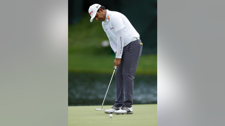 Anirban Lahiri watches his putt on the 16th hole during the first round of the Wells Fargo Championship golf tournament at Quail Hollow Club in Charlotte, N.C., Thursday, May 5, 2016. (AP Photo/Chuck Burton)