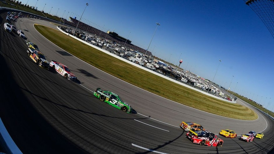 Drivers race during the NASCAR Sprint Cup Series Hollywood Casino 400 at Kansas Speedway on October 18, 2015 in Kansas City, Kansas.