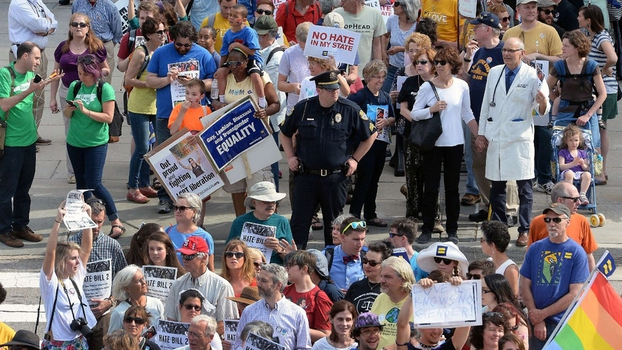 FILE - In this April 25, 2016 file photo, protesters head into the Legislative building for a sit-in against the new North Carolina transgender law in Raleigh, N.C.