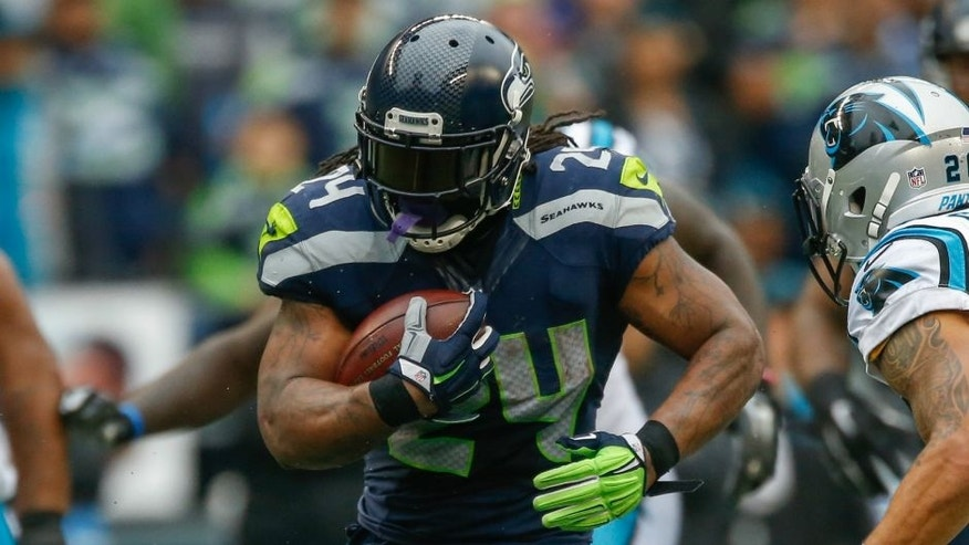 SEATTLE, WA - OCTOBER 18: Running back Marshawn Lynch #24 of the Seattle Seahawks rushes against the Carolina Panthers at CenturyLink Field on October 18, 2015 in Seattle, Washington. The Panthers defeated the Seahawks 27-23. (Photo by Otto Greule Jr/Getty Images) *** Local Caption *** Marshawn Lynch,SEATTLE, WA - OCTOBER 18: Running back Marshawn Lynch #24 of the Seattle Seahawks rushes against the Carolina Panthers at CenturyLink Field on October 18, 2015 in Seattle, Washington. The Panthers defeated the Seahawks 27-23. (Photo by Otto Greule Jr/Getty Images)
