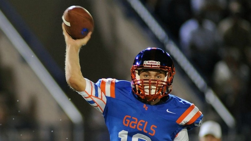 Sep 26, 2014; Las Vegas, NV, USA; Bishop Gorman Gaels quarterback Tate Martell (18) looks to pass the ball during a game against St. John Bosco High School at Fertitta Field. Bishop Gorman won the game 34-31. Mandatory Credit: Stephen R. Sylvanie-USA TODAY Sports