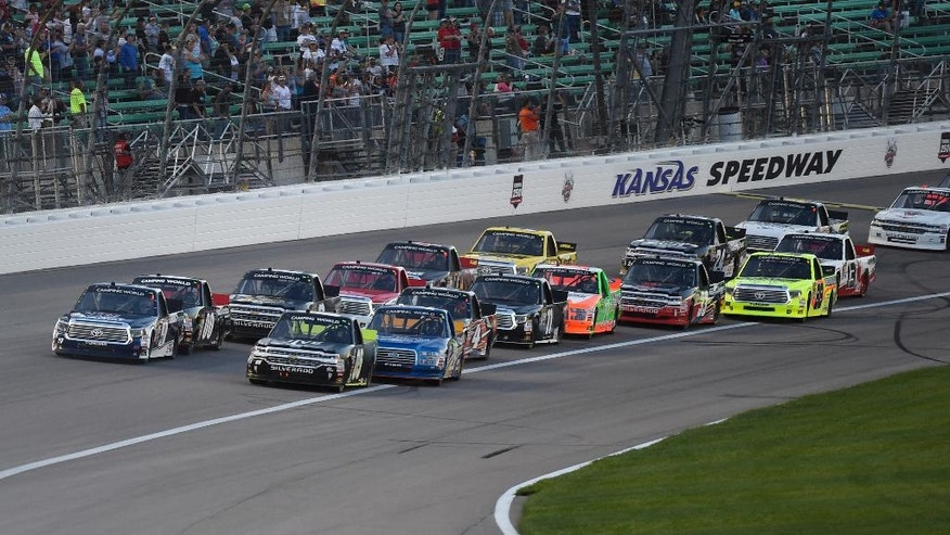 The trucks were packed up at the start of a Camping World Truck Series race at Kansas Speedway in Kansas City, Kan., Friday, May 6, 2016. (AP Photo/Reed Hoffmann)