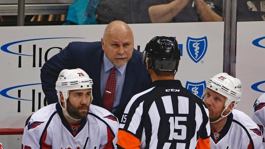 Washington Capitals head coach Barry Trotz talks to Referee Jean Hebert, (15), during the first period of Game 4 against the Pittsburgh Penguins in an NHL hockey Stanley Cup Eastern Conference semifinals in Pittsburgh, Wednesday, May 4, 2016. (AP Photo/Gene J. Puskar)
