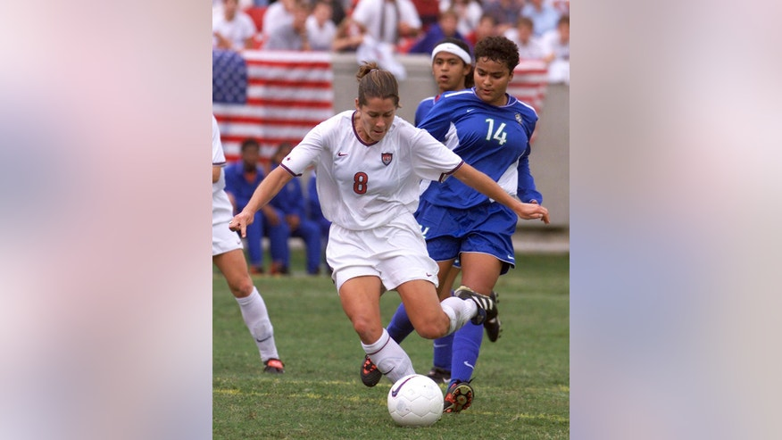File-This Oct. 10, 1999. file photo shows United States forward Shannon MacMillan taking a shot on goal during first half action of their game in Louisville, Ky. World Cup champions Brandi Chastain and MacMillan, and MLS Commissioner Don Garber have been elected to the National Soccer Hall of Fame.(AP Photo/Timothy D. Easley, File)