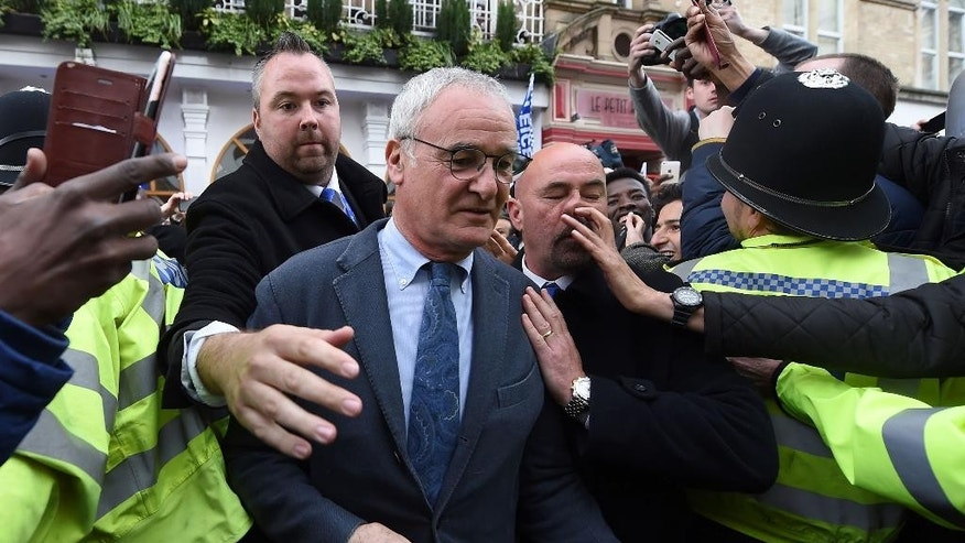 Leicester City manger Claudio Ranieri, leaves San Carlo Pizzeria after a celebratory lunch in Leicester, England Tuesday May 3, 2016. Leicester  clinched the most improbable title of the Premier League era when second-place Tottenham was held to a 2-2 draw at Chelsea on Monday night.  (Joe Giddens/PA via AP)  UNITED KINGDOM OUT