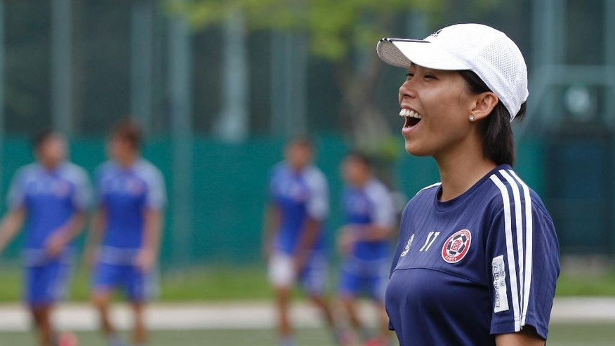 Eastern Sports Club head coach Chan Yuen-ting, laughs during a training session in Hong Kong, Friday, May 6, 2016. Chan has became the first woman in the world to coach a top-division men's team to a national championship. Chan, 27, led Eastern Sports Club to the Hong Kong Premier League title this season. (AP Photo/Kin Cheung)