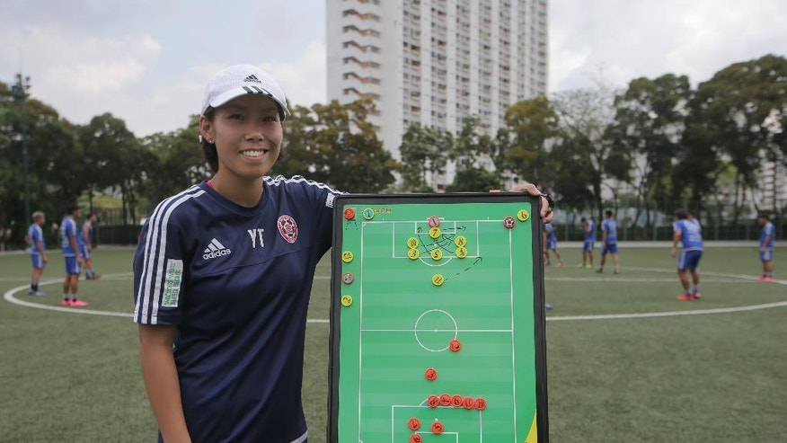 Eastern Sports Club head coach Chan Yuen-ting poses during a training session in Hong Kong, Friday, May 6, 2016. Chan has became the first woman in the world to coach a top-division men's team to a national championship. Chan, 27, led Eastern Sports Club to the Hong Kong Premier League title this season. (AP Photo/Kin Cheung)