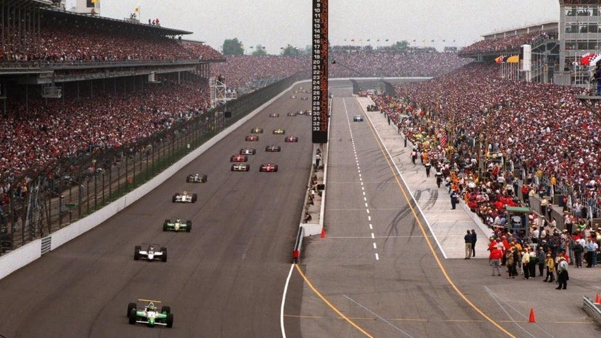 FILE - In this May 26, 1996 file photo, Tony Stewart leads Eliseo Salazar into the first turn during the 80th running of the Indianapolis 500 auto race at Indianapolis Motor Speedway. (AP Photo/ Amy Sancetta, File)