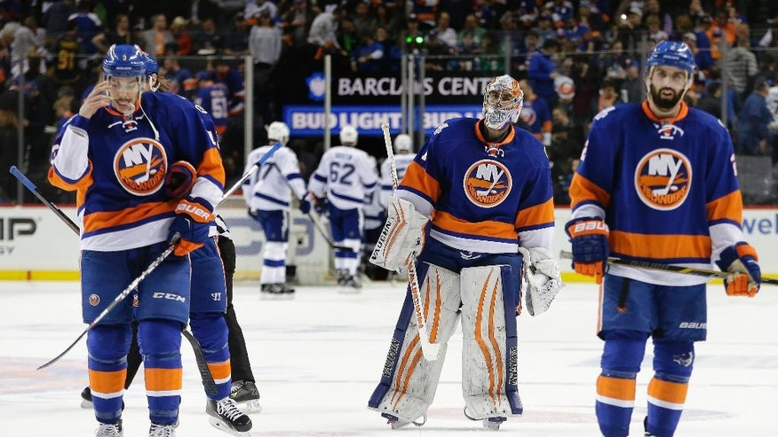 The New York Islanders skate off the ice at the end of the second period of Game 3 of the NHL hockey Stanley Cup Eastern Conference semifinals against the Tampa Bay Lightning, Tuesday, May 3, 2016, in New York. (AP Photo/Frank Franklin II)