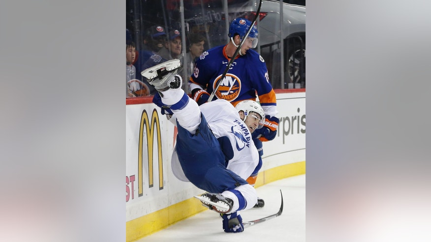 Tampa Bay Lightning center Tyler Johnson, left, takes a hit from New York Islanders center Brock Nelson (29) during the second period of Game 3 of the NHL hockey Stanley Cup Eastern Conference semifinals, Tuesday, May 3, 2016, in New York. (AP Photo/Frank Franklin II)