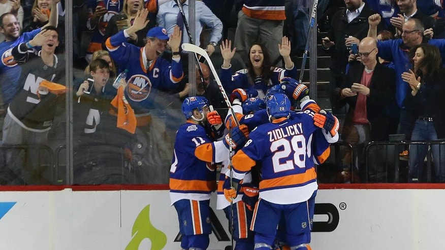 The New York Islanders celebrate a goal by left wing Josh Bailey against the Tampa Bay Lightning during the third period of Game 3 of the NHL hockey Stanley Cup Eastern Conference semifinals, Tuesday, May 3, 2016, in New York. (AP Photo/Frank Franklin II)