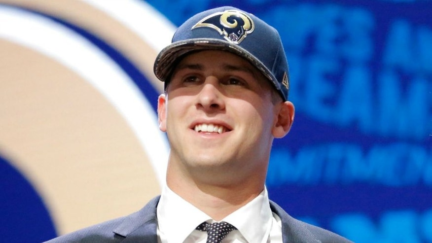 during the first round of the 2016 NFL Draft at the Auditorium Theatre of Roosevelt University on April 28, 2016 in Chicago, Illinois.,CHICAGO, IL - APRIL 28: (L-R) Jared Goff of the California Golden Bears holds up a jersey with NFL Commissioner Roger Goodell after being picked #1 overall by the Los Angeles Rams during the first round of the 2016 NFL Draft at the Auditorium Theatre of Roosevelt University on April 28, 2016 in Chicago, Illinois. (Photo by Jon Durr/Getty Images)