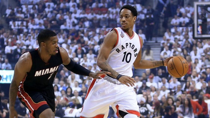 TORONTO, ON - MAY 05: DeMar DeRozan #10 of the Toronto Raptors dribbles the ball as Joe Johnson #2 of the Miami Heat defends in the first half of Game Two of the Eastern Conference Semifinals during the 2016 NBA Playoffs at the Air Canada Centre on May 5, 2016 in Toronto, Ontario, Canada. NOTE TO USER: User expressly acknowledges and agrees that, by downloading and or using this photograph, User is consenting to the terms and conditions of the Getty Images License Agreement. (Photo by Vaughn Ridley/Getty Images)