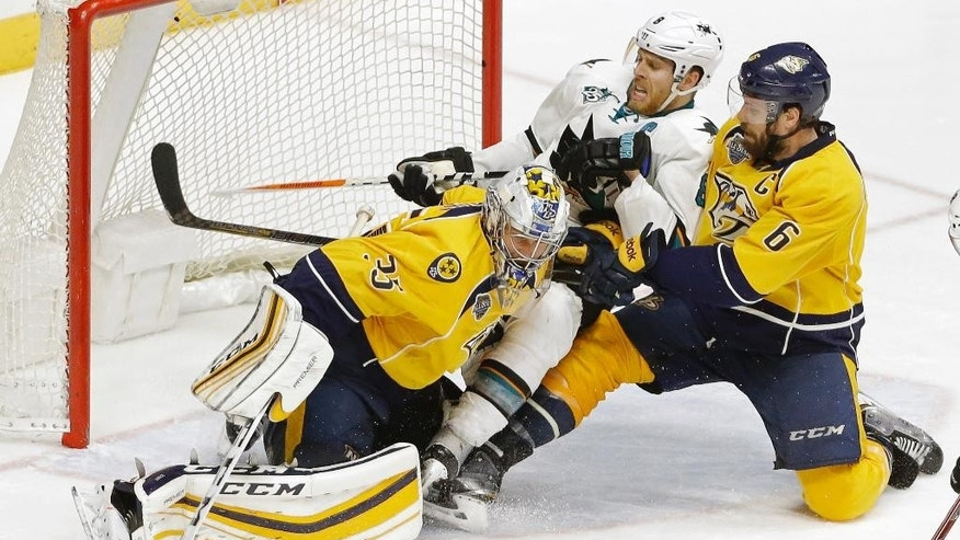 San Jose Sharks center Joe Pavelski (8) and Nashville Predators defenseman Shea Weber (6) slide into Predators goalie Pekka Rinne (35), of Finland, during the second overtime period in Game 4 of an NHL hockey Stanley Cup Western Conference semifinal playoff series Friday, May 6, 2016, in Nashville, Tenn. (AP Photo/Mark Humphrey)