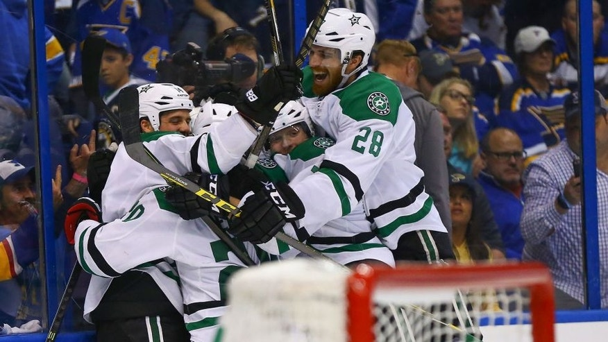 ST. LOUIS, MO - MAY 5: Stephen Johns #28 of the Dallas Stars celebrates with teammates after beating the St. Louis Blues in overtime in Game Four of the Western Conference Second Round during the 2016 NHL Stanley Cup Playoffs at the Scottrade Center on May 5, 2016 in St. Louis, Missouri. (Photo by Dilip Vishwanat/Getty Images)