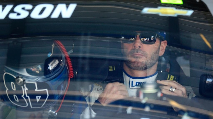 NASCAR driver Jimmie Johnson (48) sits in his race car waiting for Sprint Cup Series practice at Kansas Speedway in Kansas City, Kan., Friday, May 6, 2016. (AP Photo/Orlin Wagner)