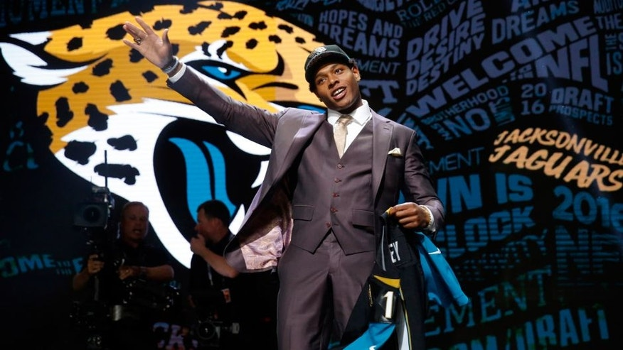 Florida State's Jalen Ramsey poses for photos after being selected by Jacksonville Jaguars as fifth pick in the first round of the 2016 NFL football draft, Thursday, April 28, 2016, in Chicago. (AP Photo/Charles Rex Arbogast)