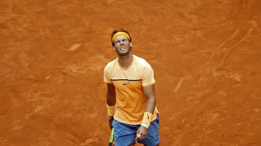 Rafael Nadal, from Spain, gestures after losing a point to Andy Murray, from Britain, during their semifinal match at the Madrid Open tennis tournament match in Madrid, Spain, Saturday, May 7, 2016. Murray won 7-5, 6-4 and will play the final on Sunday 8. (AP Photo/Francisco Seco)