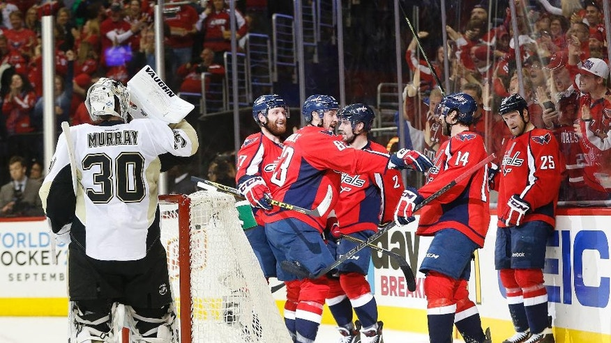Washington Capitals right wing Justin Williams (14) celebrates his goal against Pittsburgh Penguins goalie Matt Murray (30) with his teammates during the second period of Game 5 in an NHL hockey Stanley Cup Eastern Conference semifinals Saturday, May 7, 2016 in Washington. (AP Photo/Pablo Martinez Monsivais)