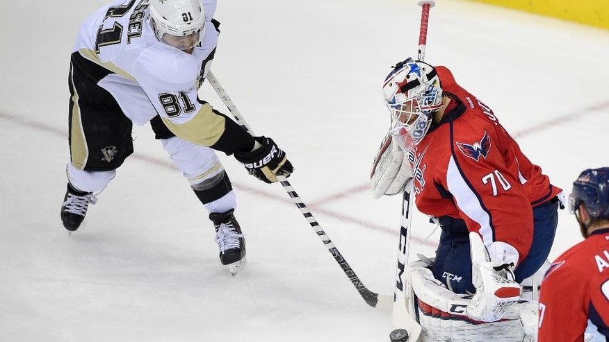 Washington Capitals goalie Braden Holtby (70) stops a shot by Pittsburgh Penguins right wing Phil Kessel (81) during the first period of Game 5 in an NHL hockey Stanley Cup Eastern Conference semifinals, Saturday, May 7, 2016, in Washington. (AP Photo/Nick Wass)