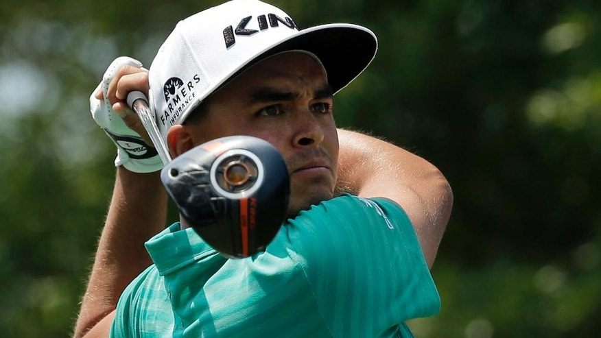 Rickie Fowler watches his tee shot on the third hole during the third round of the Wells Fargo Championship golf tournament at Quail Hollow Club in Charlotte, N.C., Saturday, May 7, 2016. (AP Photo/Chuck Burton)