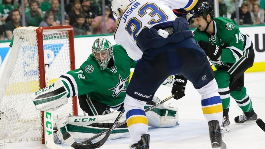 St. Louis Blues right wing Dmitrij Jaskin (23) scores a goal against Dallas Stars goalie Kari Lehtonen (32) and left wing Jamie Benn (14) during the second period of Game 5 of the NHL hockey Stanley Cup playoffs Western Conference semifinals Saturday, May 7, 2016, in Dallas. (AP Photo/LM Otero)