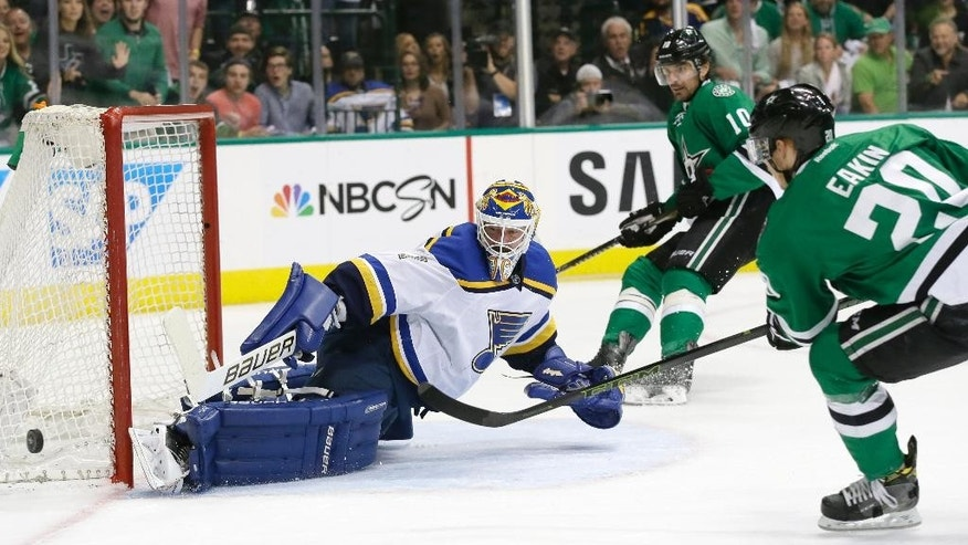 St. Louis Blues goalie Brian Elliott (1) defends the goal against Dallas Stars left wing Patrick Sharp (10) and center Cody Eakin (20) during the first period of Game 5 of the NHL hockey Stanley Cup playoffs Western Conference semifinals Saturday, May 7, 2016, in Dallas. (AP Photo/LM Otero)