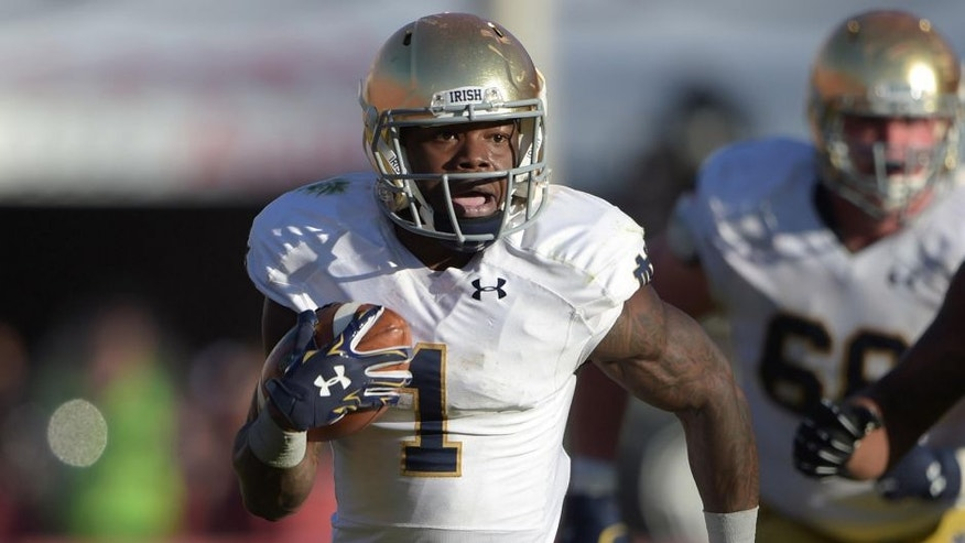 Nov 29, 2014; Los Angeles, CA, USA; Notre Dame Fighting Irish running back Greg Bryant (1) carries the ball against the Southern California Trojans at Los Angeles Memorial Coliseum. USC defeated Notre Dame 49-14. Mandatory Credit: Kirby Lee-USA TODAY Sports