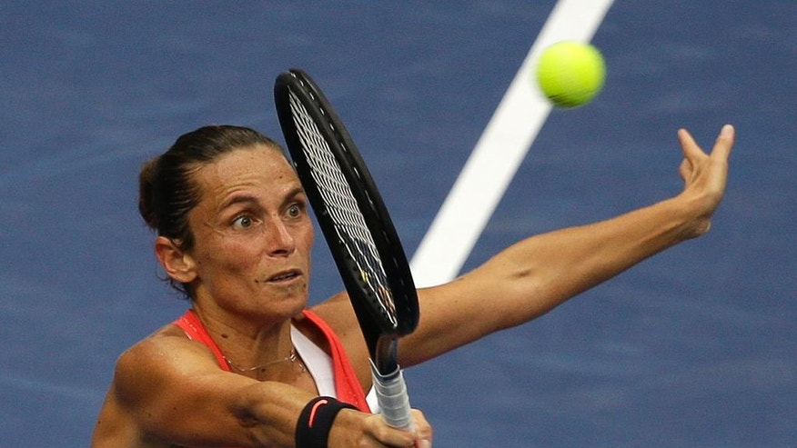 FILE -- In this Sept. 12, 2015 file photo, Roberta Vinci, of Italy, returns a shot to Flavia Pennetta, of Italy, during the women's championship match of the U.S. Open tennis tournament in New York. Seven months after ending Serena Williams' bid for a calendar-year Grand Slam in the semifinals of the U.S. Open, Vinci will be the local favorite at the Italian Open this week. (AP Photo/Seth Wenig)