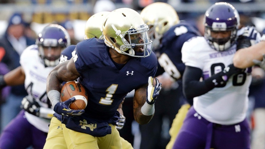 In this Nov. 15, 2014, file photo, Notre Dame running back Greg Bryant (1) runs with the ball against Northwestern during the first half of an NCAA college football game in South Bend, Ind.