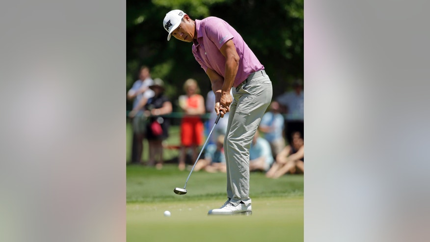 James Hahn putts on the first hole during the final round of the Wells Fargo Championship golf tournament at Quail Hollow Club in Charlotte, N.C., Sunday, May 8, 2016. (AP Photo/Chuck Burton)