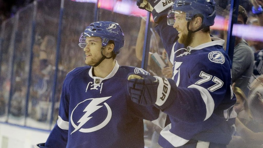 Tampa Bay Lightning's Victor Hedman (77), of Sweden, waves at his team after scoring a goal during the second period of Game 5 of the NHL hockey Stanley Cup Eastern Conference semifinals against the New York Islanders, Sunday, May 8, 2016, in Tampa, Fla. Tampa Bay Lightning's Jonathan Drouin (27) is at left. (AP Photo/Chris O'Meara)