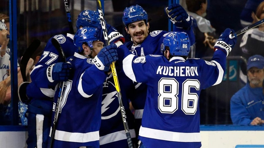 May 8, 2016; Tampa, FL, USA; Tampa Bay Lightning defenseman Victor Hedman (77) is congratulated by right wing Nikita Kucherov (86) and teammates after scored a goal against the New York Islanders during the second period in game five of the second round of the 2016 Stanley Cup Playoffs at Amalie Arena. Mandatory Credit: Kim Klement-USA TODAY Sports