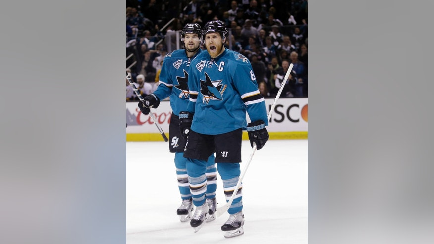 San Jose Sharks' Joe Pavelski (8) celebrates alongside teammate Marc-Edouard Vlasic after scoring against the Nashville Predators during the first period of Game 5 in an NHL hockey Stanley Cup Western Conference semifinal series Saturday, May 7, 2016, in San Jose, Calif. (AP Photo/Marcio Jose Sanchez)