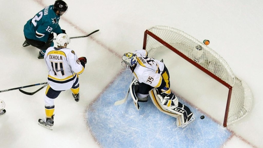 Nashville Predators goalie Pekka Rinne (35) is beaten for a goal on a shot from San Jose Sharks' Patrick Marleau, top left, during the first period of Game 5 in an NHL hockey Stanley Cup Western Conference semifinal series Saturday, May 7, 2016, in San Jose, Calif. (AP Photo/Marcio Jose Sanchez)
