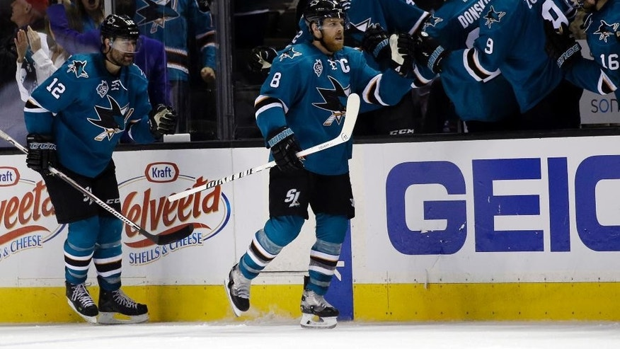 San Jose Sharks' Joe Pavelski (8) celebrates with teammates after scoring against the Nashville Predators during the second period of Game 5 in an NHL hockey Stanley Cup Western Conference semifinal series Saturday, May 7, 2016, in San Jose, Calif. (AP Photo/Marcio Jose Sanchez)