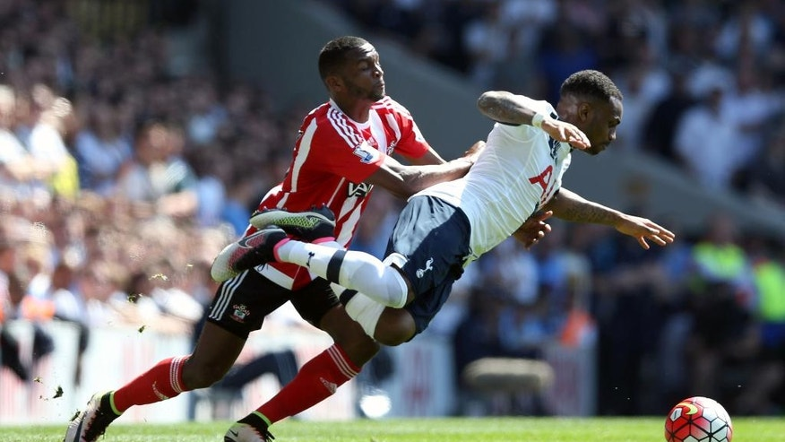 Southampton's Cuco Martina, left, and Tottenham Hotspur's Danny Rose battle for the ball during the English Premier League soccer match at White Hart Lane, London, Sunday May 8, 2016. (Adam Davy/PA via AP) UNITED KINGDOM OUT