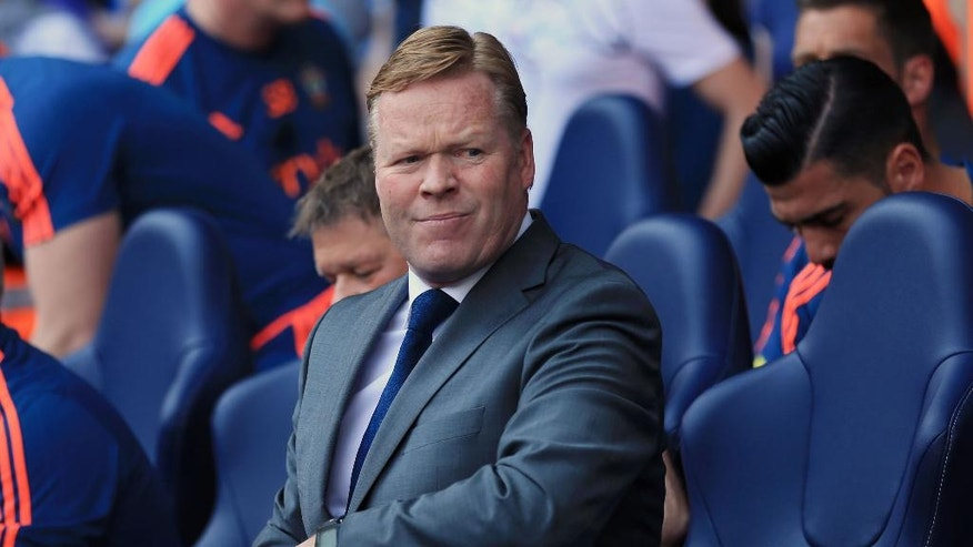 Southampton manager Ronald Koeman takes his seat prior to the English Premier League soccer match against Tottenham Hotspur at White Hart Lane, London, Sunday May 8, 2016. (Adam Davy/PA via AP) UNITED KINGDOM OUT