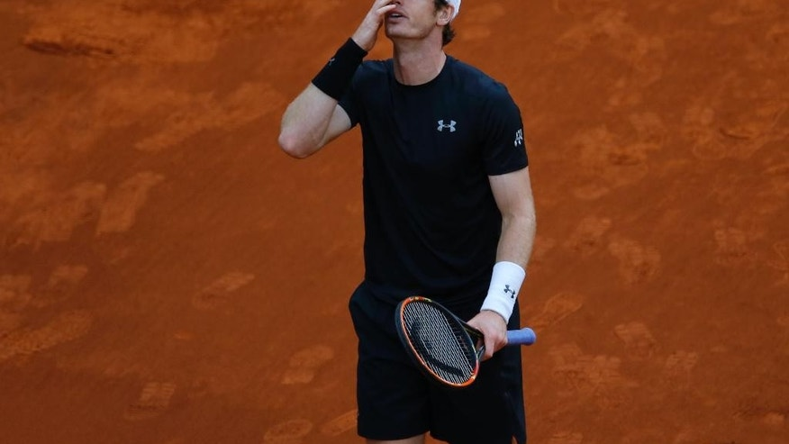 Andy Murray, from Britain, gestures after losing a point to Novak Djokovic, from Serbia, during their Madrid Open tennis tournament final match in Madrid, Spain, Sunday, May 8, 2016. Djokovic won 6-2, 3-6 and 6-3. (AP Photo/Francisco Seco)