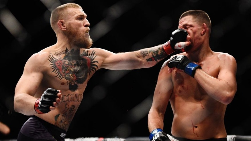 LAS VEGAS, NV - MARCH 05: (L-R) Conor McGregor of Ireland punches Nate Diaz during the UFC 196 event inside MGM Grand Garden Arena on March 5, 2016 in Las Vegas, Nevada. (Photo by Jeff Bottari/Zuffa LLC/Zuffa LLC via Getty Images)