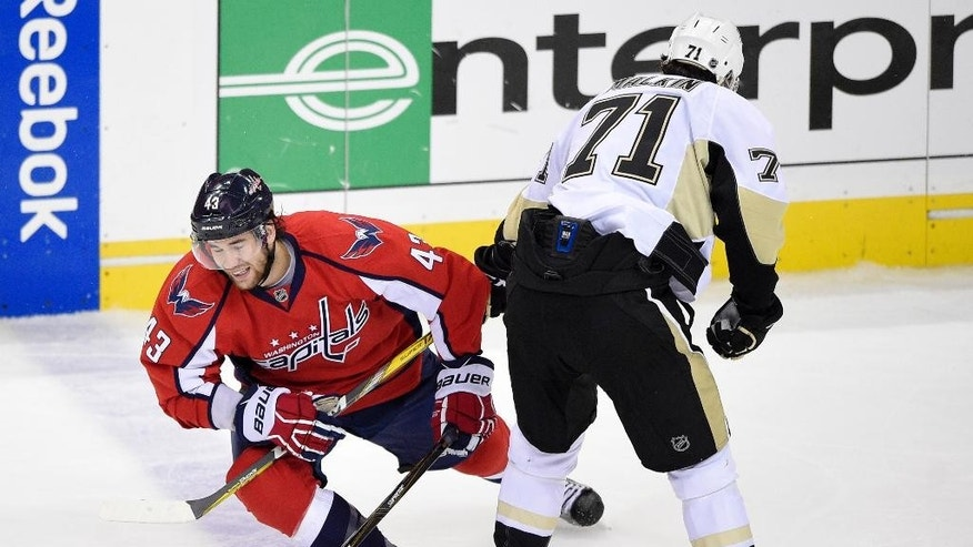 Washington Capitals right wing Tom Wilson (43) tangles with Pittsburgh Penguins center Evgeni Malkin (71), of Russia, during the third period of Game 5 in an NHL hockey Stanley Cup Eastern Conference semifinals, Saturday, May 7, 2016, in Washington. The Capitals won 3-1. (AP Photo/Nick Wass)