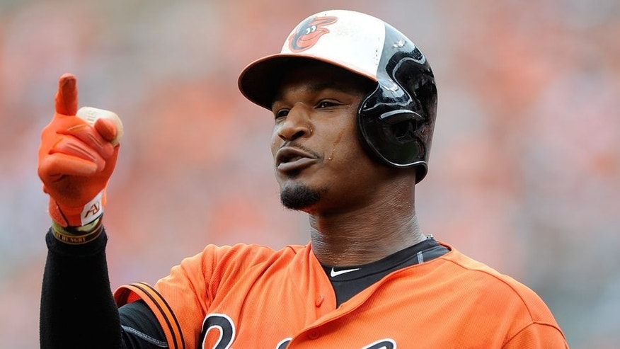 BALTIMORE, MD - JUNE 28: Adam Jones #10 of the Baltimore Orioles reacts after fouling out against the Cleveland Indians at Oriole Park at Camden Yards on June 28, 2015 in Baltimore, Maryland. (Photo by G Fiume/Getty Images)