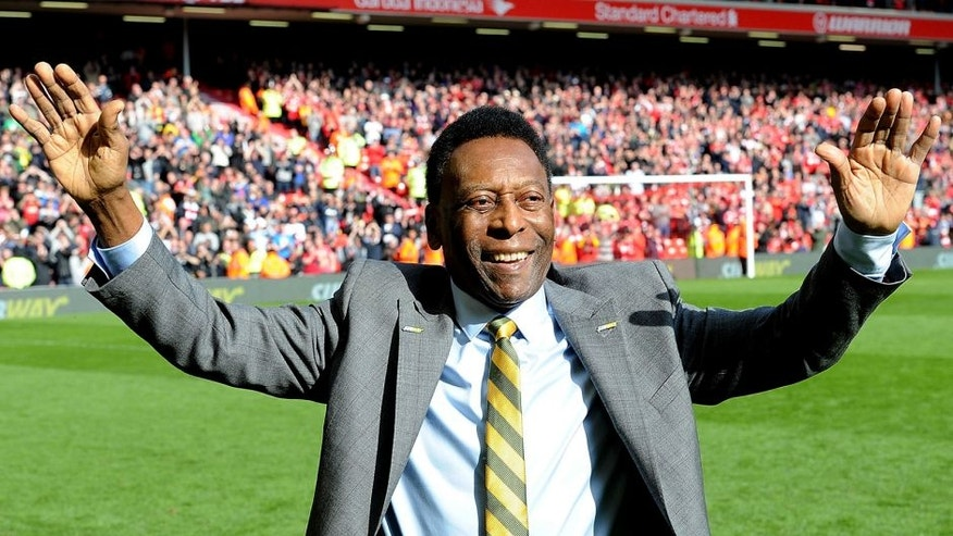 LIVERPOOL, ENGLAND - MARCH 22: (THE SUN OUT, THE SUN ON SUNDAY OUT) Pele comes onto the pitch at half time of the Barclays Premier League match between Liverpool and Manchester Untied at Anfield on March 22, 2015 in Liverpool, England. (Photo by John Powell/Liverpool FC via Getty Images)