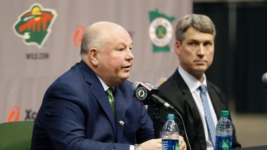 Bruce Boudreau, left, takes questions after he was introduced by Minnesota Wild general manager Chuck Fletcher, right, as the new Wild NHL hockey team head coach during a news conference by the NHL hockey team Tuesday, May 10, 2016, in St. Paul, Minn. (AP Photo/Jim Mone)
