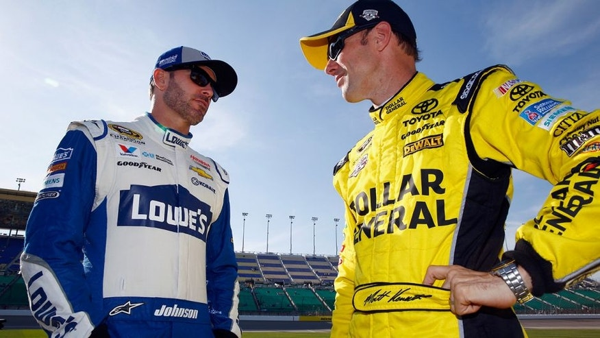 KANSAS CITY, KS - MAY 06: Matt Kenseth, driver of the #20 Dollar General Toyota, speaks with Jimmie Johnson, driver of the #48 Lowe's Chevrolet, during qualifying for the NASCAR Sprint Cup Series Go Bowling 400 at Kansas Speedway on May 6, 2016 in Kansas City, Kansas. (Photo by Jamie Squire/Getty Images)