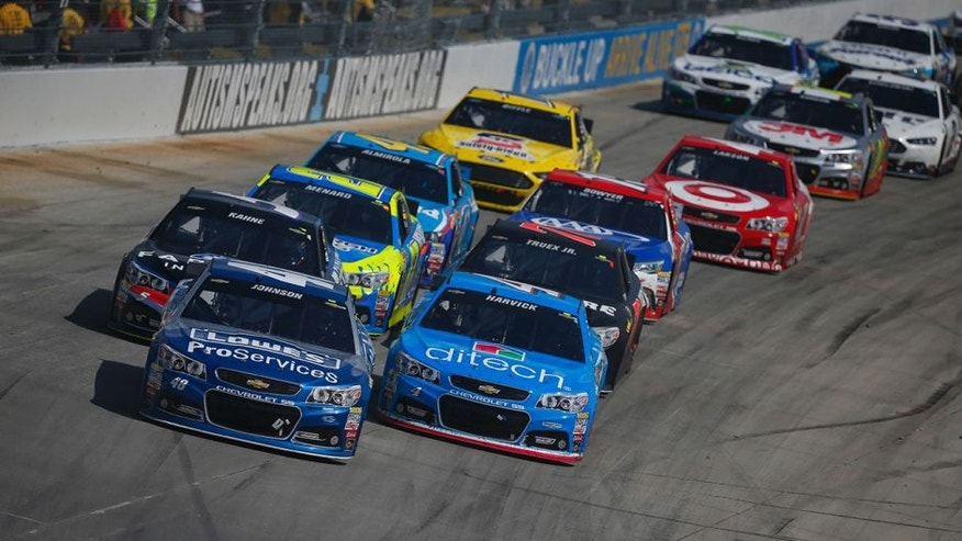 Jimmie Johnson, driver of the #48 Lowe's Pro Services Chevrolet, leads a pack of cars during the NASCAR Sprint Cup Series FedEx 400 Benefiting Autism Speaks at Dover International Speedway on May 31, 2015 in Dover, Delaware.