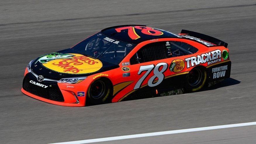 KANSAS CITY, KS - MAY 06: Martin Truex Jr., driver of the #78 Bass Pro Shops/TRACKER Boats Toyota Toyota, drives during practice for the NASCAR Sprint Cup Series Go Bowling 400 at Kansas Speedway on May 6, 2016 in Kansas City, Kansas. (Photo by Robert Laberge/NASCAR via Getty Images)