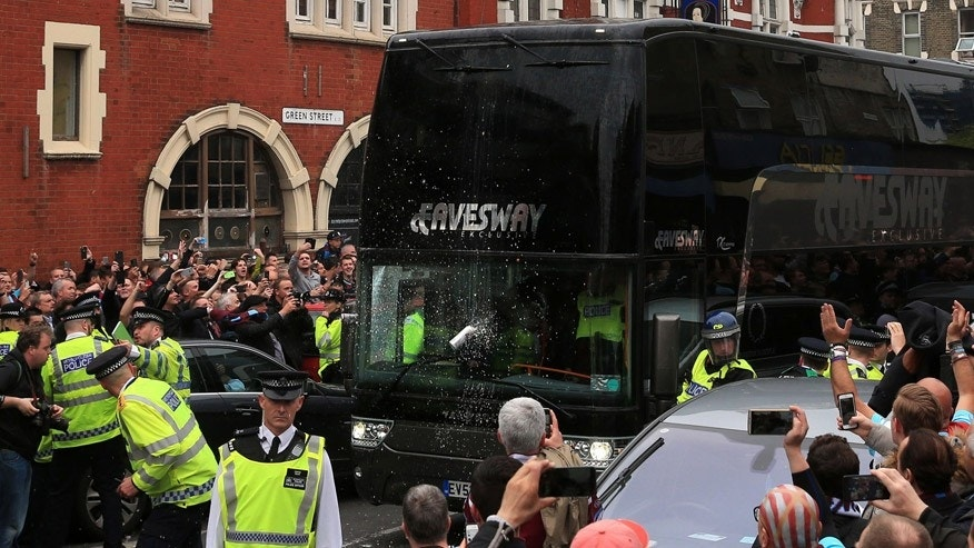 May 10, 2016: A drink can hits the screen of the Manchester United team bus as it arrives for the English Premier League soccer match against West Ham United at Upton Park.
